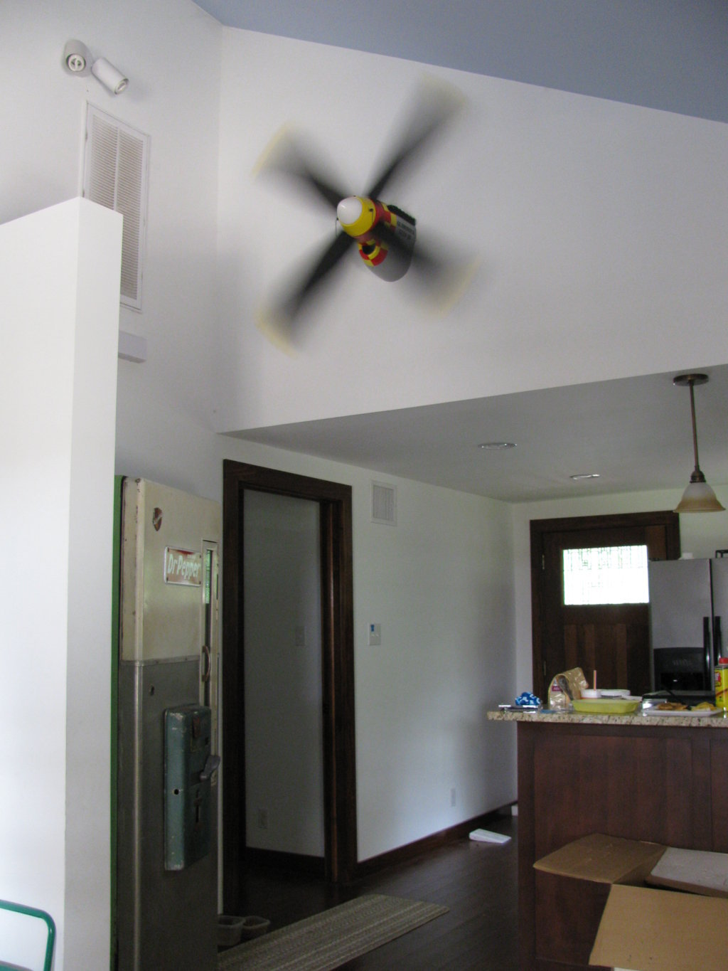 ... ceiling fan - on the wall. That's a vintage Dr.Pepper machine on the
